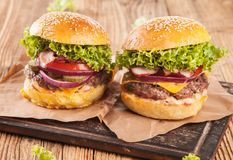 Fresh hamburger served on wood Royalty Free Stock Photography