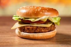 Fresh hamburger on wooden table Royalty Free Stock Photo