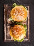 Fresh hamburgers on black stone, top view Stock Images