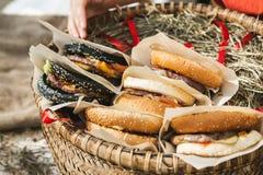 Fresh hamburgers folded in wicker basket, closeup shot.  stock photos