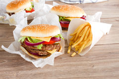 Fresh hamburgers with french fries Royalty Free Stock Image