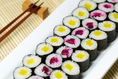 Fresh Hand Rolled Pickled Sushi in Large White Plate Royalty Free Stock Image