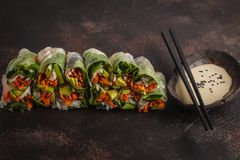 Fresh handmade vegan asian spring rolls with rice noodles, avoca stock photo