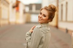 Fresh happy portrait of a beautiful funny woman with. A smile in a fashionable jacket in the city stock images