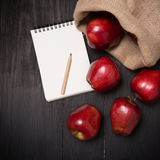 Fresh harvest of apples with paper note on black table, Nature f Stock Image