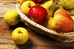 Fresh harvest of apples and pears. Stock Photo