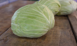 Fresh Harvest Green Cabbage. On Wood Grungy Table Royalty Free Stock Images