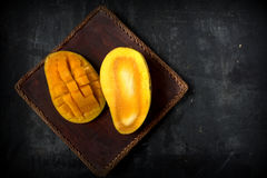 Fresh harvest mango. Fruit with classic wooden background Stock Image