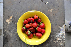 Strawberries in yellow plate Royalty Free Stock Image