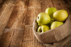 Fresh harvested apples on wood Royalty Free Stock Image