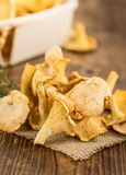 Fresh harvested Chanterelles on a wooden table. As detailed close-up shot Stock Photos