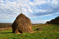 A fresh haystack with blue sky in Stock Photo