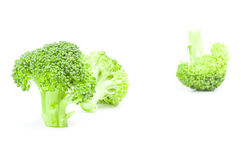 Fresh head of broccoli isolated on a white background cutout. Fresh raw broccoli isolated on a white background cutout Royalty Free Stock Photography