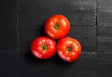 Fresh and Health Tomatoes over Black Slate Stock Images