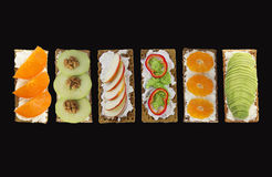 Fresh healthy appetizer snack with crispbread on black background. Stock Images