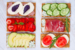 Fresh healthy appetizer snack with crispbread, fruits, berries, hamon and cheese. Stock Photography