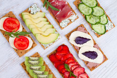 Fresh healthy appetizer snack with crispbread, fruits, berries, hamon and cheese. Royalty Free Stock Photography