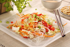 Fresh healthy asian salad with rice noodles and nuts Stock Photos
