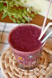 Healthy fresh smoothie with blueberry and papaya fruits. Fresh healthy blueberry and papaya smoothie on a glass decorated on a wooden table Stock Photos