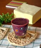 Healthy fresh smoothie with blueberry and papaya fruits. Fresh healthy blueberry and papaya smoothie on a glass decorated on a wooden table Stock Image