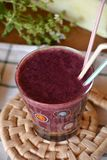 Healthy fresh smoothie with blueberry and papaya fruits. Fresh healthy blueberry and papaya smoothie on a glass decorated on a wooden table Stock Photo