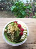 Fresh healthy breakfast. Acai bowl with raspberries banana bee pollen and kiwis in the morning stock photography