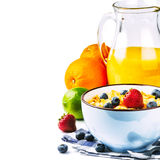 Fresh healthy breakfast with cereals and fruits. Fresh healthy breakfast with cereals, fruits and orange juice Royalty Free Stock Photos