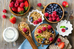 Fresh healthy breakfast with muesli and berries, vitamins, woode Royalty Free Stock Photography