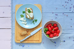 Fresh healthy breakfast, a slice of soda bread with butter and cottage cheese and red radish. Fresh healthy breakfast, a slice of soda bread with butter, cottage Royalty Free Stock Images