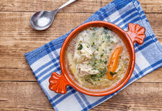 Fresh and healthy chicken soup with vegetables. On wooden background Royalty Free Stock Photo