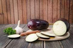 Fresh healthy eggplants. On dark wooden background Royalty Free Stock Images
