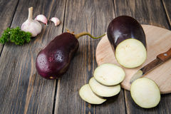 Fresh healthy eggplants. On dark wooden background Royalty Free Stock Image