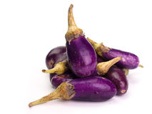 Fresh healthy eggplants. Placed on a  White background Stock Photo