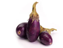 Fresh healthy eggplants. Placed on a  White background Royalty Free Stock Photo
