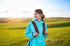 Fresh and healthy female model during hike outdoors in field. Stock Image