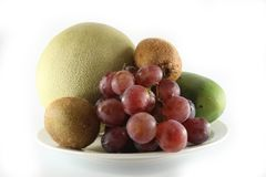 Fresh Fruits & plate Stock Photography
