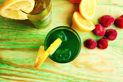 Fresh healthy fruit juices on a wooden abstract background Royalty Free Stock Photography