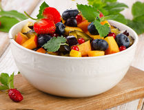 Fresh healthy fruit salad. In white bowl. Selective focus Stock Image