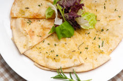 Garlic pita bread pizza with salad on top Royalty Free Stock Photography