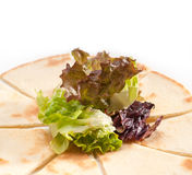 Garlic pita bread pizza with salad on top Stock Image