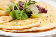 Garlic pita bread pizza with salad on top Stock Photos