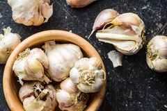 Fresh healthy garlic in wooden bowl. Top view Royalty Free Stock Image