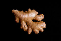 Fresh healthy ginger Root. Isolated on Black Royalty Free Stock Photo