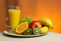 Fresh. A healthy fresh juice along some fruits royalty free stock photos