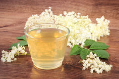 Fresh healthy juice and elderberry flowers on rustic board Stock Photo