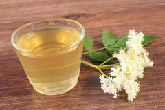 Fresh healthy juice and elderberry flowers on rustic board Royalty Free Stock Photo