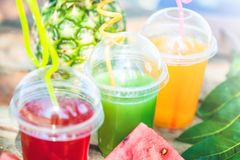 Fresh healthy juices, fruit, pineapple, watermelon on the background of the sea. Summer, rest, healthy lifestyle Close. Up stock images