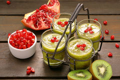 Fresh healthy kiwi drink with pomegranate in metal container Royalty Free Stock Images