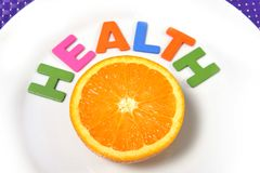 Fresh healthy Orange Fruit and health word on plate Stock Images