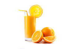 Fresh healthy orange juice and slices of oranges Royalty Free Stock Photo